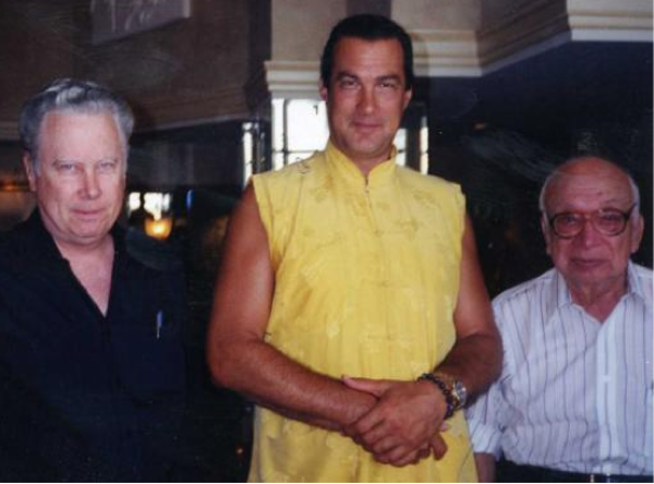 A photo of John Alexander, Steven Segal, and Phil Corso.