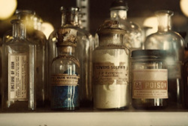 A pleasant photo of some antique labeled bottles.