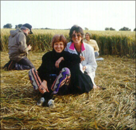 Suzanne Taylor and a friend in a crop circle.